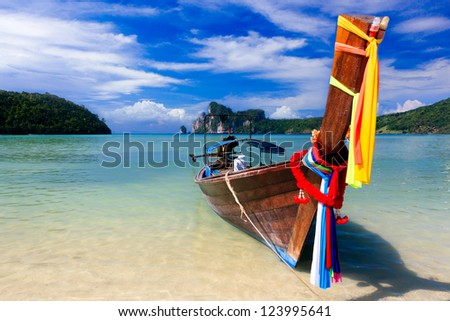 Traditional longtail boats in bay of Phi-phi island, Thailand - stock photo