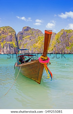Traditional longtail boats in the famous Maya bay of Phi-phi Don island, Thailand