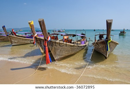 Traditional longtail boats on the Ao Nang beach, Krabi province, Thailand