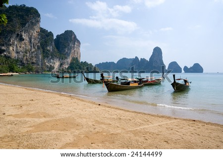 Traditional longtail boats on the Tonsai beach, Krabi province, Thailand - stock photo