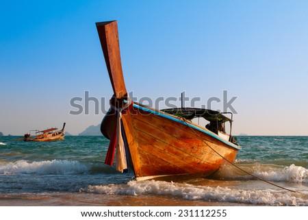 Traditional longtail wooden boat at Andaman sea - stock photo