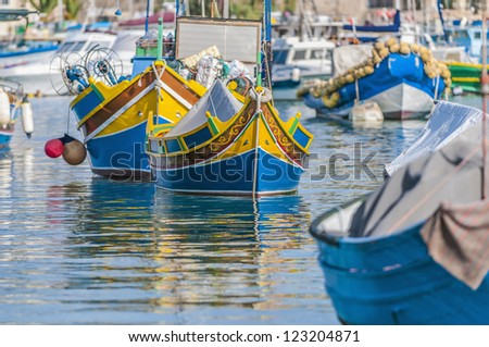Traditional Luzzu boat at Marsaxlokk harbor, a fishing village located in the south-eastern part of Malta.