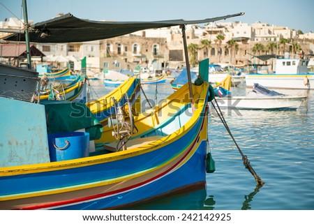 Traditional luzzu boat at Marsaxlokk village, Malta - stock photo