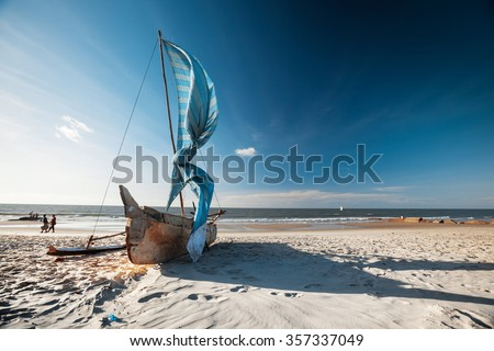 Traditional Malagasy sail boat on the sea coast. Town of Morondava, Madagascar - stock photo