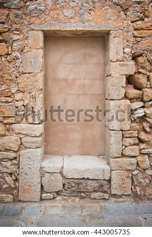 Traditional Mallorca stone wall background texture with rough drystone and smooth center copy space. - stock photo