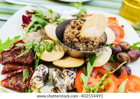 Traditional maltese appetizer with tuna, cheese and tomatoes. - stock photo