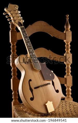 traditional mandolin on old chair - stock photo