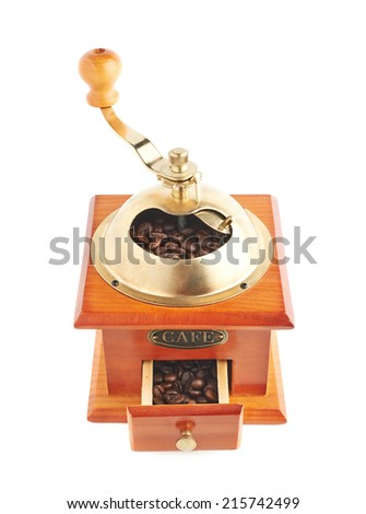 Traditional manual wooden coffee grinder isolated over the white background - stock photo