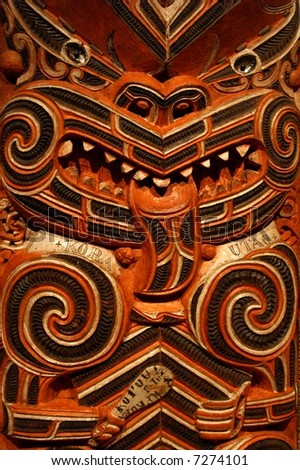 Traditional Maori Wood Carving in a Meeting House - stock photo
