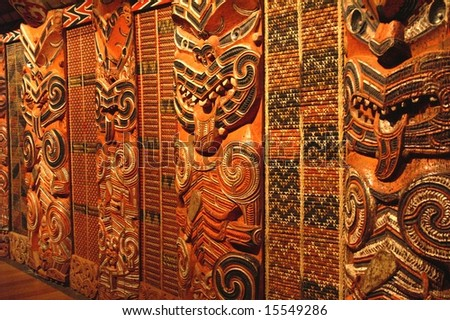 Traditional Maori Wood Carvings in Meeting House - stock photo