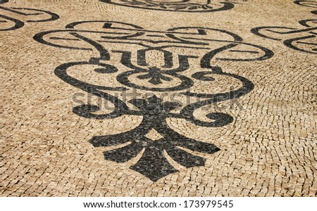 Traditional marble mosaic on street in Lisbon (Portugal) - stock photo
