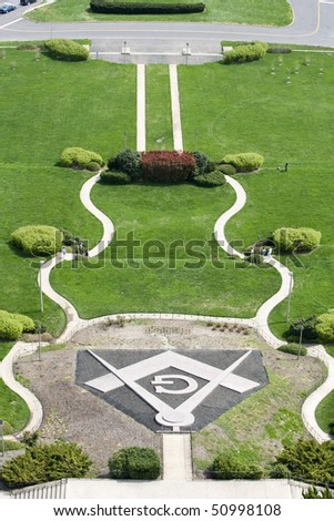 Traditional masonic symbol  in front of the building - stock photo