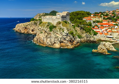 Traditional Mediterranean houses with red tiled roofs and rocky coastline,Dubrovnik,Dalmatia,Croatia,Europe - stock photo