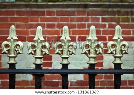 Traditional metal railings in front of a wall - stock photo