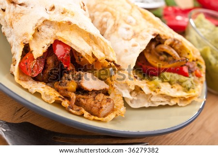 traditional mexican chicken and beef  fajitas with guacamole - stock photo