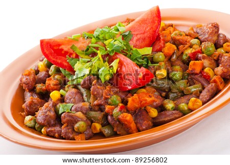 Traditional mexican chili with kidney beans and tomato on white background - stock photo