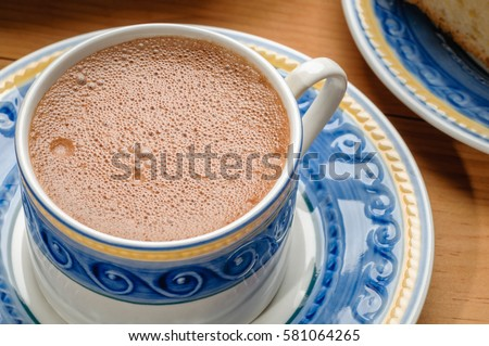 Traditional Mexican Chocolate Cup Made With Cinnamon And Beaten With Wooden Utensil Called Molinillo