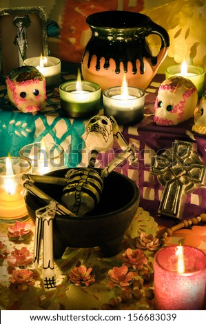 Traditional mexican Day of the dead altar with skeleton, sugar skulls and candles - stock photo