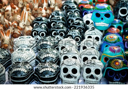 Traditional mexican day of the dead souvenir ceramic skulls at market stall - stock photo