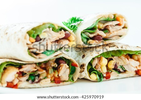 Traditional Mexican Food -  Burrito, on white wooden retro table
