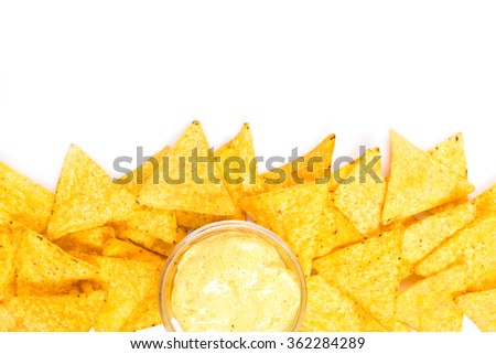 Traditional mexican nachos with cheese sauce on white