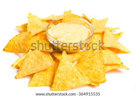 Traditional mexican nachos with cheese sauce on white - stock photo