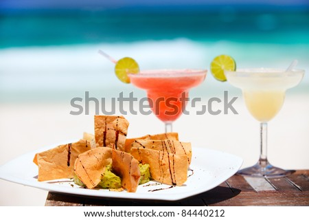 Traditional mexican tortilla chips and margarita cocktails - stock photo