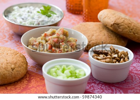 Traditional meze buffet with oriental dips from aubergines and from yoghurt with cucumbers.
