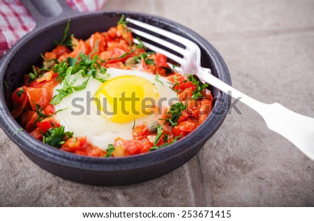 Traditional Middle Eastern dish of Shakshuka in a pan