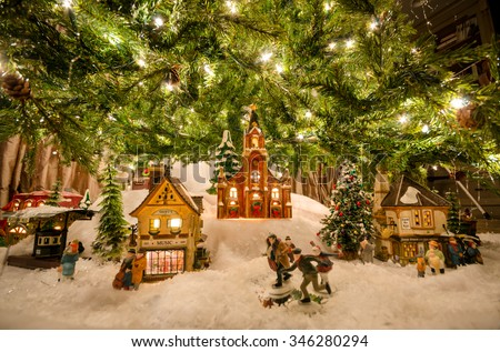 traditional miniature christmas village beneath tree - Lights For Christmas Village