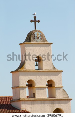 traditional mission bells with cross and seagull in santa barbara - stock photo