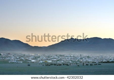 Traditional Mongolian village at sunset - stock photo