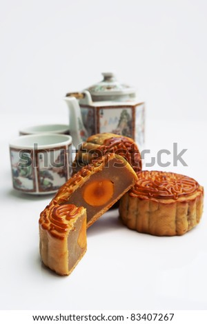 Traditional Mooncake with tea pot as background - stock photo