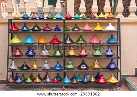 Traditional Moroccan craftsmanship, brightly painted ceramic pots - stock photo