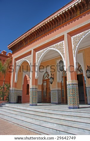 Traditional Moroccan doorways with ornate arches, in Marrakesh - stock photo