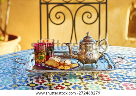 Traditional Moroccan mint tea with sweets - stock photo