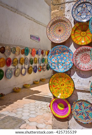 Traditional Moroccan painted clayware on the walls of the streets in Morocco. - stock photo