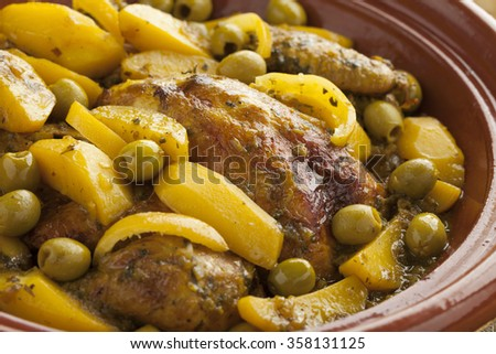 Traditional moroccan tajine with chicken,pototoes and olives close up