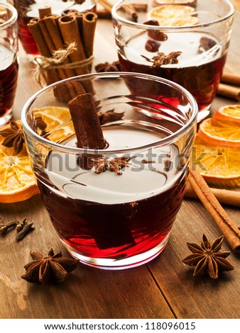 Traditional mulled wine with spices. Shallow dof. - stock photo