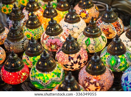 Traditional multicolored eastern glass lamps lighting on Asian market  - stock photo