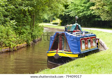 traditional narrow boat moored on the banks of the llangollen canal in wales, uk. - stock photo