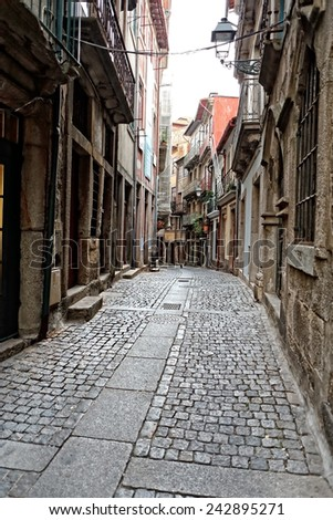 Traditional narrow street from Oporto. Morning light. Unesco site - stock photo