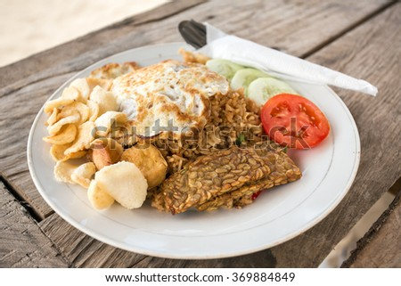 Traditional Nasi Goreng with fried egg and tempe - stock photo