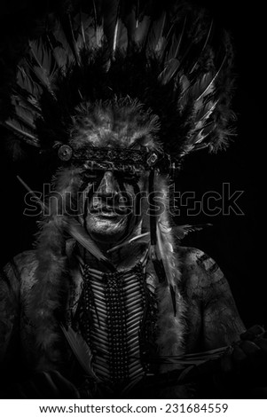 traditional Native, American Indian chief with big feather headdress - stock photo