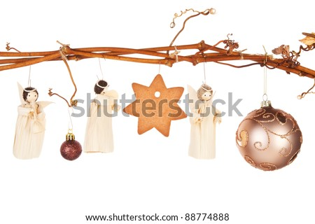 Traditional natural christmas still life. Bethlehem, the birth of Jesus and the three king with star shaped gingerbread cookie hanging from vineyard branch. - stock photo