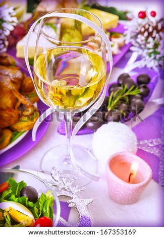 Traditional New Year beverage, champagne, glass with white wine, tasty festive food, romantic dinner, holiday celebration concept - stock photo