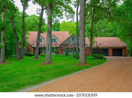 Traditional North American Residential House in Wooded Area in summer Season - stock photo