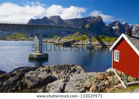 Traditional norwegian fishing house and bridge connecting islands on Lofoten in Norway