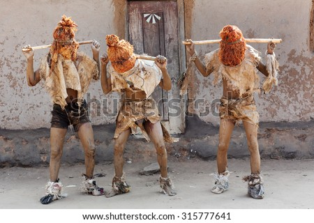 Traditional Nyau dancers with face masks at a Gule Wamkulu ceremony in a small village near Lilongwe, Malawi - stock photo