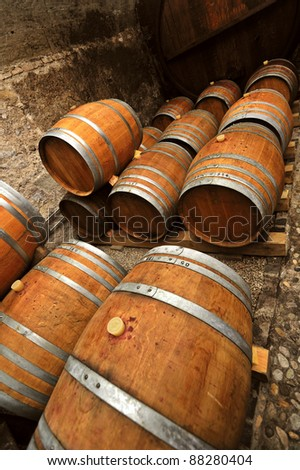 Traditional oaken barrels of fermenting wine in a Swiss wine-producer's cellar. The Swiss do produce wine but it's little-known as they drink most of it themselves. Space for text at top. - stock photo